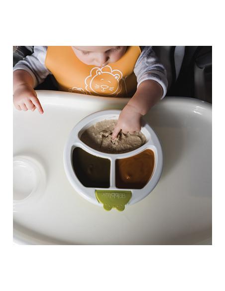 Platö - Plato con sistema de reserva de agua caliente y ventosa - Lima. Niño comiendo en el plato de color blanco y verde.