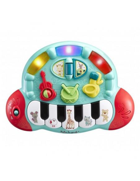 Piano' folies Sophie la girafe. Piano de juguete de color azul y rojo con botones con forma de gitarra, batería y saxofon.