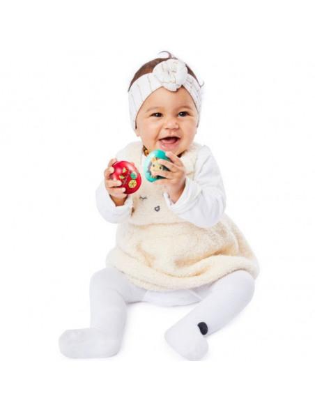 Egg shakers - Tentetieso/Maracas. Bebé sostiene dos huevos de juguete de color rojo y azul