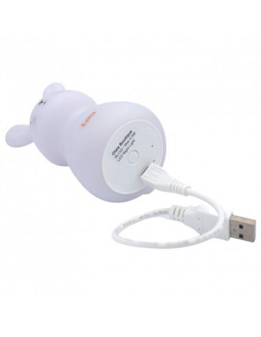 Luz Quitamiedos Individual USB. Luz blanca con forma de conejito con un cargador USB conectado al conejo tumbado.