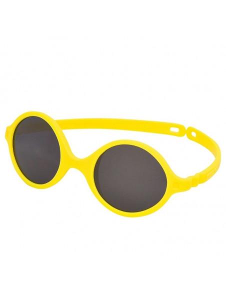 Gafas de sol para bebés de color amarillo de perfil